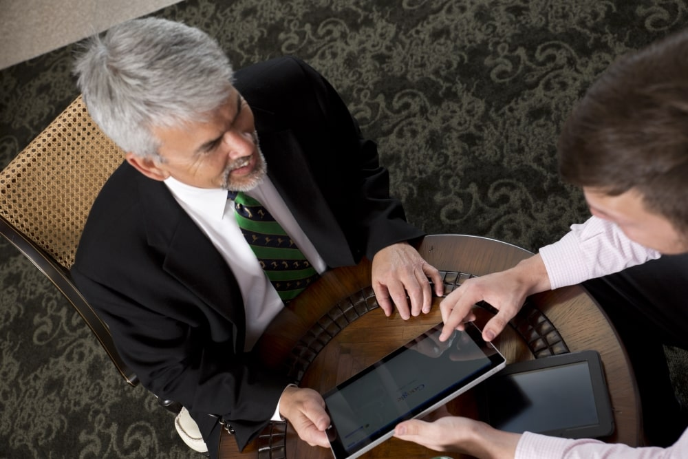 Two Men Working on Tablet